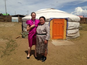 Me and my host mom wearing our deels in front of my ger. My host mom's friend made mine for me.